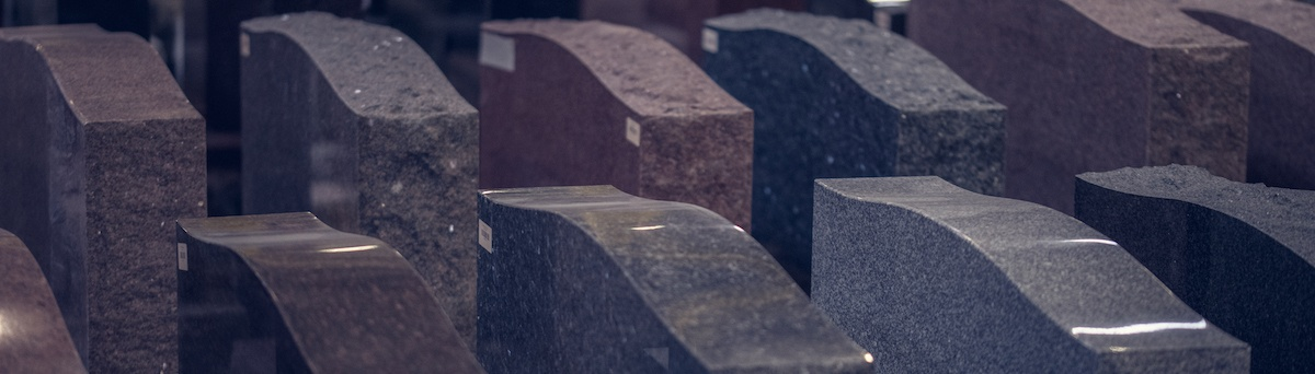Granite Memorials backed by Rock of Ages