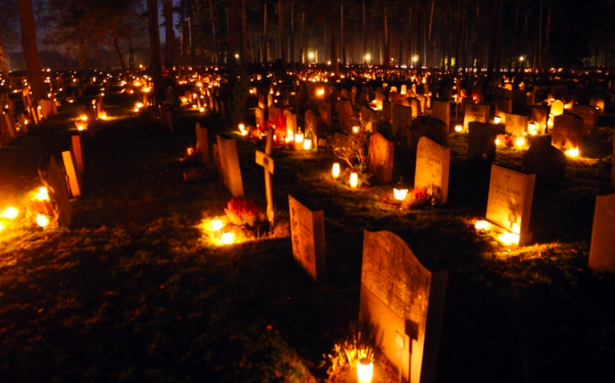 Lanterns at cemetery graves for all saints day and all souls day