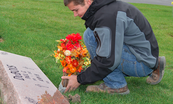 Michael Placing Flowers in an In-Ground Vase